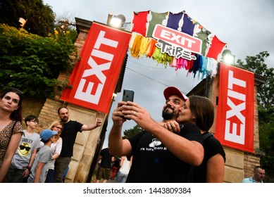 Novi Sad, Serbia - 04 July 2019: Visitors making selfies with their phones as they arrive to Exit festival. The 19th Exit festival with the theme of Tribe started at Petrovaradin fortress.
