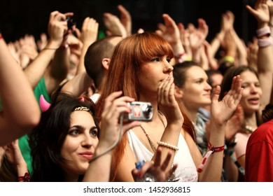 NOVI SAD, SERBIA - 10 JULY 2010: Girls in front of the Main Stage during Royksopp's performance at the Music Festival - EXIT 2010, 10 July 2010 at the Petrovaradin Fortress in Novi Sad, Serbia.