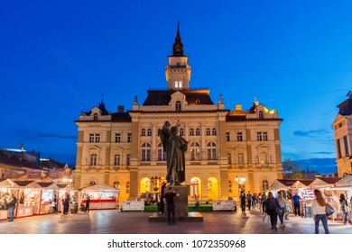 Novi Sad, Serbia April 11, 2018: Night view of the central square in Novi Sad, Serbia and monument of Svetozar Miletic.