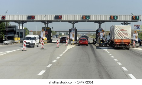 NOVI SAD, SERBIA - CIRCA JULY 2013: Drivers pays road toll at E-75 highway on corridor 10 circa July 2013 in Novi Sad