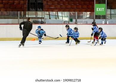 Novi Sad, Serbia - December 05, 2020 :Youth ice hockey team from Novi Sad trains with their coach