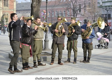 Novi Sad, Serbia - December 31, 2012: People in the city with trumpets before the new year
