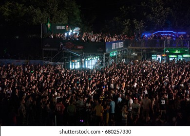 NOVI SAD, SERBIA - JULY 6, 2017: People cheering during the 2017 edition of the Exit Festival in Novi Sad, Serbia. Exit festival is one of the biggest music festival in southeastern Europe