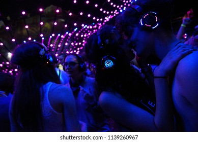 NOVI SAD, SERBIA - JULY 9, 2017: Young couple kissing enjoying silent disco stage at Exit festival on July 9, 2017 in Petrovaradin fortress in Novi Sad, Serbia