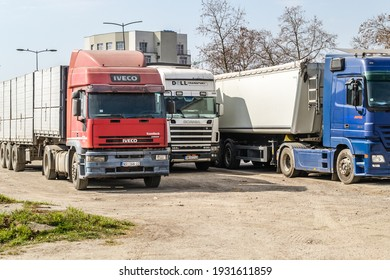 Novi Sad, Serbia - March 05. 2021: Parked transport trucks next to the highway near Novi Sad, Serbia.