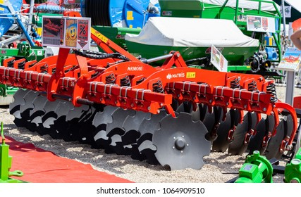 Novi Sad, Serbia: may 9. 2015 - Novi Sad Agro fair with people and Fair show. Modern tractors and harvester on display on Agricultural fair
