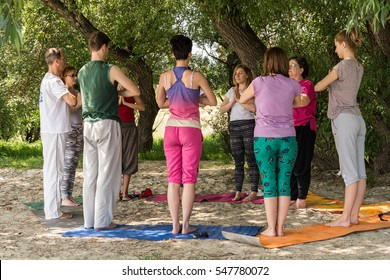Novi Sad, Serbia - May 9, 2015: Group of people practicing yoga in nature on a sunny day