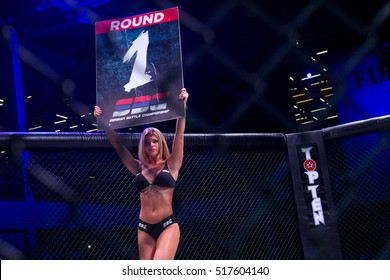 Novi Sad, Serbia - November 05 2016 : MMA - SBC fight tournament. Girl in the ring announces first round, extreme Sport. Fight night, profesional athletes.