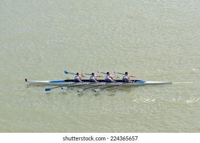 NOVI SAD, SERBIA - OCTOBER 18, 2014: Four men rowing on Danube River on traditional remote regatta competition.