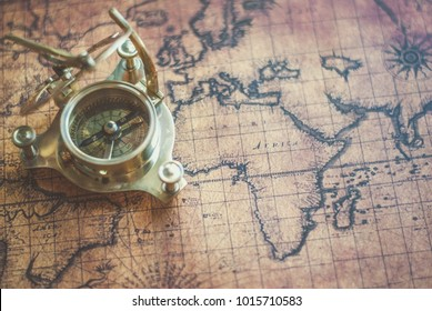 Novi Sad, Serbia - October 21, 2017: Old world map and compass. Illustrative editorial