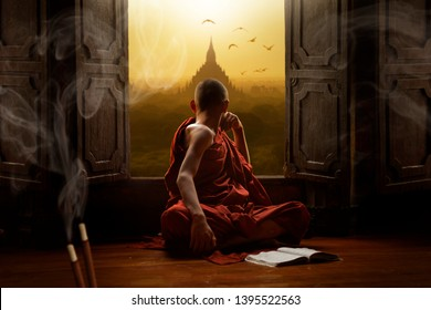 Novice buddhist monk inside a temple in the Bagan Valley