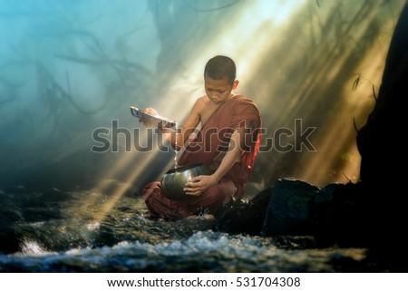 novice monk washes alms