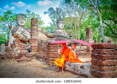 Novice Monks in ancient temple, Kamphaeng Phet Thailand, The children Monks walking on ancient temple, The young monk Thai Buddhist novice little monk stay, Thailand.