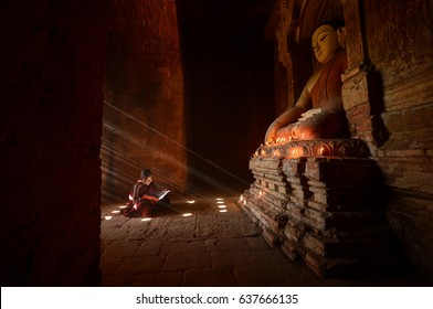 Novice monks in the plain of bagan on during sunrise,Myanmar