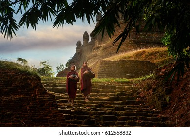 Novice monks in the plain of mrauk-u Ratanabon Paya on during sunrise,Myanmar