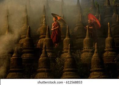 Novice monks in the plain of mrauk-u Ratanabon Paya on during sunrise,Mrauk-u Myanmar