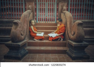 Novice monks reading book of Buddhism and spiritual religion of Buddha in the temple of Thailand