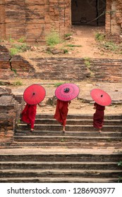 Novice monks walking together in ancient temple Mandalay Myanmar.