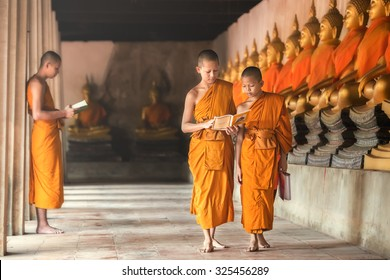 Novices at Ayutthaya Historical Park in Thailand