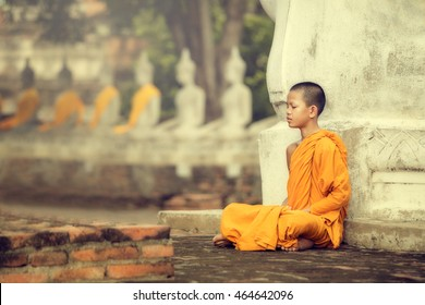 Novices monk vipassana meditation at Ayutthaya Historical Park in Thailand