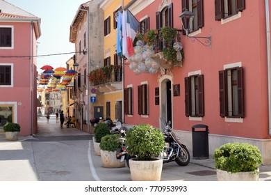 NOVIGRAD, CROATIA - AUGUST 31, 2017: Street view of Novigrad. Novigrad is a small Istrian coastal town with narrow winding streets; small shops and pleasant cafes.