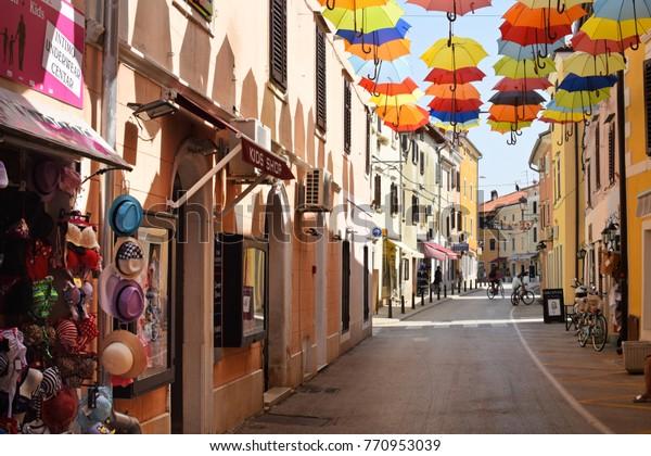 NOVIGRAD, CROATIA - AUGUST 31, 2017: Narrow winding street in Novigrad. Novigrad is a small Istrian coastal town with narrow winding streets; small shops and pleasant cafes.