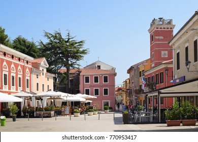NOVIGRAD, CROATIA - SEPTEMBER 1, 2017: Quiet square in Novigrad.  Novigrad is a small Istrian coastal town with narrow winding streets; small shops and pleasant cafes.