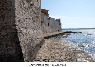 NOVIGRAD, CROATIA - SEPTEMBER 29: Beach in the small idyllic city Novigrad located on the west coast of Istria peninsula, Croatia, on September 29, 2017.