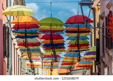 Novigrad, Istria, Croatia, August 2018. From the festival of street artists, the town is decorated with hundreds of colored umbrellas: looking up we meet a kaleidoscope of bright colors