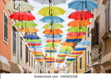 Novigrad, Istria, Croatia, Europe - Picturesque colorful umbrellas in the alleyways of Novigrad
