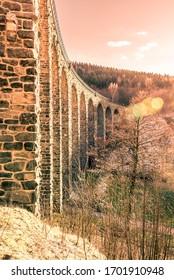 Novina Viaduct - old stone railway bridge near Krystofovo Udoli, Czech Republic. - Shutterstock ID 1701910948