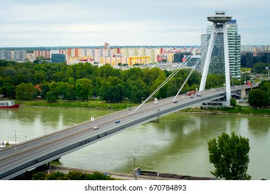 Novo most, New bridge of Bratislava with colorful cityscape in the background