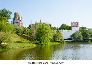 Novodevichy Convent, also Bogoroditse-Smolensky Monastery located in the southwestern part of Moscow on bank of the Moscow River during early summer seen from the pond in Moscow , Russia.