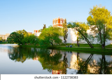 The Novodevichy Convent, also Bogoroditse-Smolensky Monastery from the pond,locals in the park. Moscow, Russia.