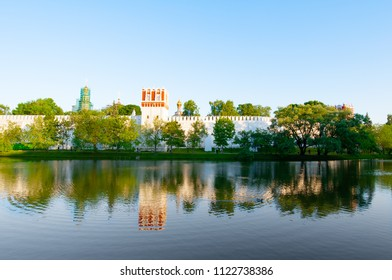 The Novodevichy Convent, also Bogoroditse-Smolensky Monastery seen from the pond under sunset in Moscow , Russia.
