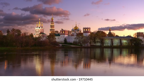Novodevichy convent in the evening (view from the lake). Panorama.
