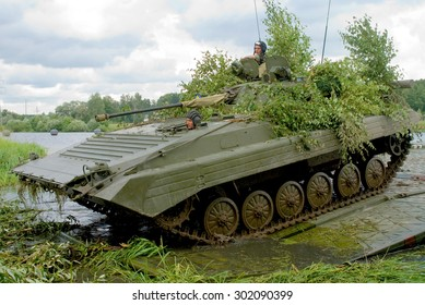 Novograd Volynsky, Ukraine - 25 July 2007. Fighting vehicle BMP-2 crossing the river on a pontoon bridge, during maneuvers.