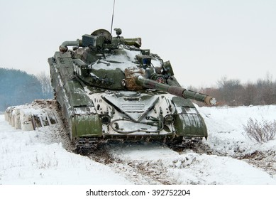 Novograd Volynsky, Ukraine - January 25. 2012. Main Battle Tank T-64 is moving on snow-covered terrain.