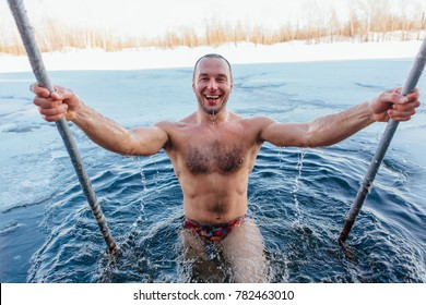 Novokuznetsk, Kemerovo region, Russia - 23 Feb, 2017 : White beaches of Siberia is an enterteiment activity where people playing beach games dressed in bikini in winter. A man swimming in an ice hole