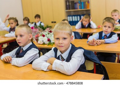 NOVOKUZNETSK, KEMEROVO REGION, RUSSIA - SEP, 1, 2016: First-grade students and teacher are in school classroom at first lesson. The day of knowledge in Russia.