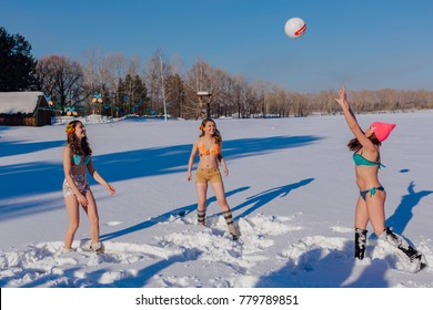 Novokuznetsk, Kemerovo region, Russia-23 Feb, 2017: White beaches of Siberia is an enterteiment activity where people playing beach games dressed in bikini in winter. Women playing volleyball on snow