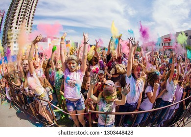 NOVOKUZNETSK, KEMEROVO REGION, RUSSIA-AUGUST 04, 2018 :: A group of a young people on the festival of colors Holi in Russia, Novokuznetsk 04 August, 2018.