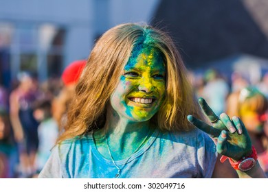 NOVOKUZNETSK, KEMEROVO REGION, RUSSIA-AUGUST 20, 2014 :: Portrait of a young girl on the festival of colors Holi in Russia, Novokuznetsk 20 August 2014.