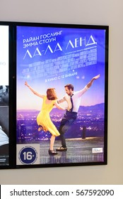 """Novokuznetsk, Russia - january 13, 2017: """"La La Land"""" is American romantic musical comedy-drama film directed by Damien Chazelle and starring Ryan Gosling and Emma Stone. Poster at IMAX  cinema."""