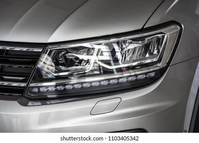 Novokuznetsk, Russia - September 02, 2017: Headlight Volkswagen Tiguan in dealership Volkswagen in Novokuznetsk