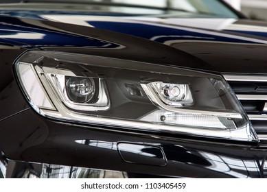 Novokuznetsk, Russia - September 02, 2017: Headlight Volkswagen Touareg R-Line in dealership Volkswagen in Novokuznetsk