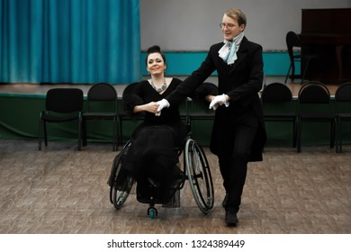 Novokuznetsk/Russia, 06.02.2018: inclusive dance, waltz with a girl with disabilities