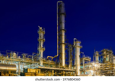 Novomoskovsk, Russia - May 2021: Chemical plant, petrochemical factory at night. Petro chemical power industry refinery enterprise of methanol. Late night industrial landscape background