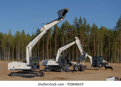 NOVOPRIOZERSK HIGHWAY, LENINGRAD REGION, RUSSIA - SEPTEMBER 11, 2015: Excavator competitions during the final of Russian professional skills championship of road workers