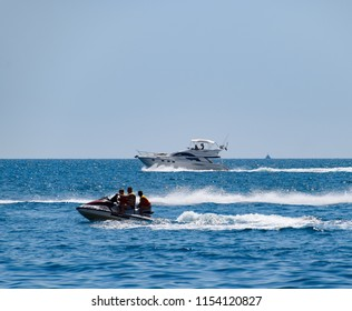 Novorossiysk, Russia - August 06, 2018: Motor transport in the sea, cutter, hydrosculator and boat.